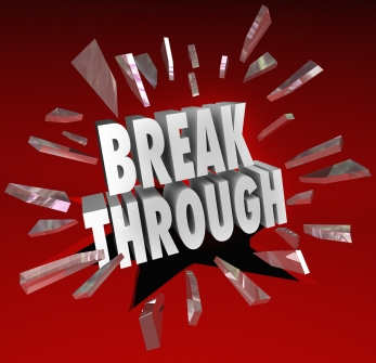 The word Breakthrough breaking through glass to symbolize discovery, invention, creativity, ideas and brainstorming